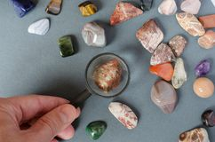Collection of precious stones on a gray background royalty free stock images