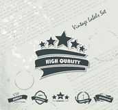 Collection of Premium Quality and Guarantee Labels on the Old Ne. Wspaper Royalty Free Illustration