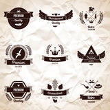 Collection of Premium Quality and Guarantee Labels. Vector illustration. Crumpled paper textured backdrop. Triangle shaped sign in hipster style. Laurel wreath Royalty Free Stock Photography