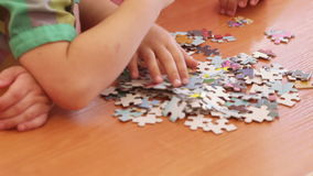 Collection of puzzles. Children collect pictures of puzzles. Two scenes stock footage