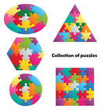 Collection of puzzles - 5 colorful figures Stock Photo