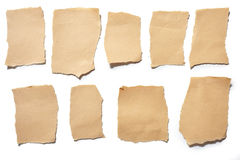 Collection real brown paper torn or ripped pieces of paper in white background Stock Images
