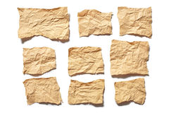 Collection real brown paper torn or ripped pieces of paper in white background Stock Photography