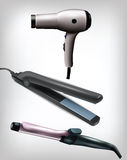 Collection of realistic flat iron, curling iron and hair dryer Stock Photo