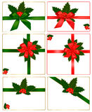 Collection of red bows with ribbons and holly Stock Photo