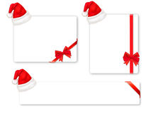 Collection of red bows and Santa hats. Royalty Free Stock Image