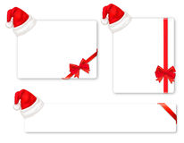 Collection of red bows and Santa hats. Vector. Stock Photo