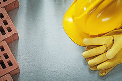 Collection of red bricks building helmet protective gloves on co Royalty Free Stock Photos