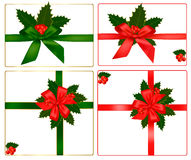 Collection of red and green bows with holly Stock Photo