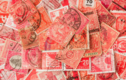 Collection of red old postage stamps Stock Photo