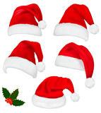 Collection of red santa hats with and holly vector illustration