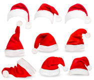 Collection of red santa hats. Royalty Free Stock Images