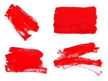 Collection of red strokes of the paint brush. Isolated on a white Royalty Free Stock Photo