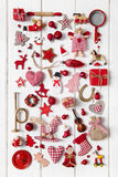 Collection of red and white checkered christmas decoration on wo. Collection of small red and white checkered christmas decoration on wooden background Stock Photo
