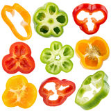 Collection of red, yellow, green pepper slices isolated Stock Images