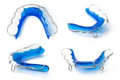 Retainer orthodontic equipment. Collection of retainer orthodontic equipment on white background Royalty Free Stock Photography