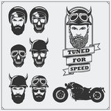 Collection of retro motorcycle labels, emblems and design elements. Helmets, goggles, bikers and racers. Vintage style. Stock Photo