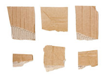 Collection of ripped  brown pieces of cardboard isolated on whit Royalty Free Stock Image