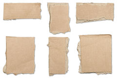 Collection of ripped  brown pieces of cardboard, shadows Stock Photos