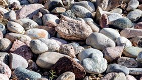 A collection of river stones smooth by the waters of the Mississippi River. Exposed to the summer sun stock images