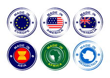 "Collection of round labels ""Made in Europe, America, Africa, Australia, Asia, Antarctica"" with flags Royalty Free Stock Photography"