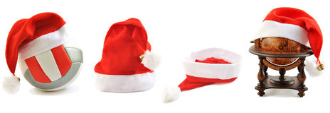Collection of Santa's hats  lined up on white. Stock Photos
