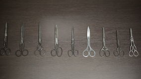 Collection of scissors from ancient to modern. HD shot with slider stock video footage