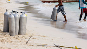 Collection of Scuba Diving Air Tanks. A collection of scuba divers air taks on a tropical white sand beach royalty free stock image