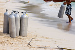 Collection of Scuba Diving Air Tanks. A collection of scuba divers air taks on a tropical white sand beach royalty free stock images