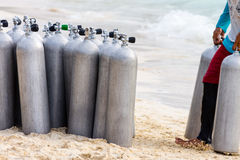 Collection of Scuba Diving Air Tanks. A collection of scuba divers air taks on a tropical white sand beach stock photography