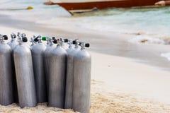 Collection of Scuba Diving Air Tanks. A collection of scuba divers air taks on a tropical white sand beach royalty free stock photos