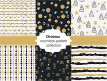 Collection of seamless patterns. Merry Christmas and Happy New Year Set of seamless backgrounds with traditional symbols. Snowflakes, pine tree, gifts Stock Photography