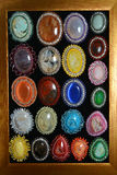 Collection of semi precious brooch on the wood frame Royalty Free Stock Photos