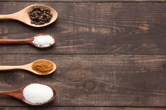 Collection set of spices on wooden spoons. ( Black pepper, salt Royalty Free Stock Images
