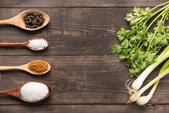 Collection set of spices on wooden spoons and vegetables. royalty free stock photo