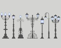 Collection of seven street lamps, isolated gray background.. Collection of seven street lamps, isolated gray background. Figured forged street lights. Vector Royalty Free Stock Photo