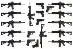 Collection of several assault rifles and pistols isolated on white background Stock Images