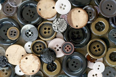Collection of sewing buttons. Background of sewing bottoms in wood, plastic and metal Royalty Free Stock Image