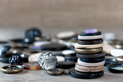 Collection of sewing buttons. Pile of sewing bottoms in wood, plastic and metal Royalty Free Stock Photo