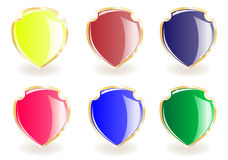 Collection from shields. Of different colours on gold Royalty Free Stock Photography