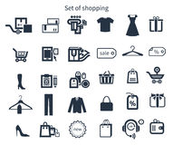 Collection of shopping icons. Such as tag, sticker, basket, bag, clothes rack, gift in black color  on white background Stock Photography