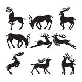 Collection of silhouettes of deer in different Stock Images