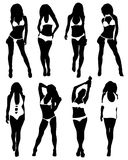 Collection of silhouettes of girls in bathing suits Stock Photo