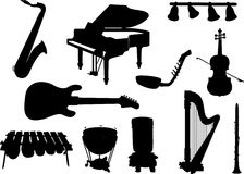 Collection of silhouettes of musical instruments. Royalty Free Stock Photo
