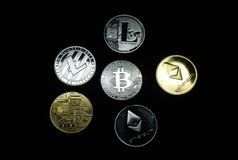 Collection of silver and gold cryptocurrency coins stock image