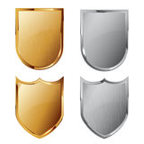 Collection of silver and golden shields Stock Photography