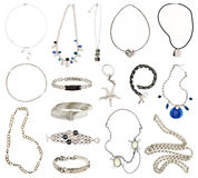 Collection of silver jewelery. Isolated on white Royalty Free Stock Photo