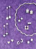 Collection of silver jewelry on purple background tone Royalty Free Stock Image