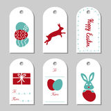 Collection of six Easter gift tags. Collection of six Easter gift tags decorated with bunnies, eggs, gift box, bunny tracks and lettering. Some bunny loves you Royalty Free Stock Image