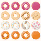 Collection of sixteen glazed colorful donuts with different flav Stock Photos